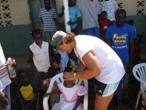 Dr. Stephanie Maj adjusting a sitting child