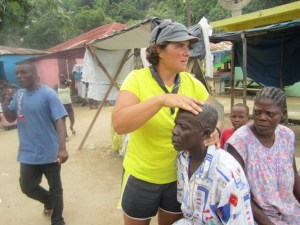 Dr. Stephanie Maj adjusting children in Haiti